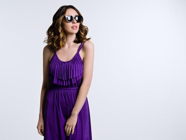 Beautiful brunette in sunglasses
