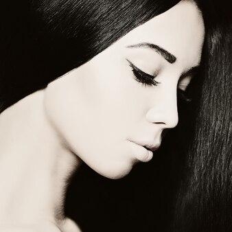 Beautiful brunette woman, face closeup