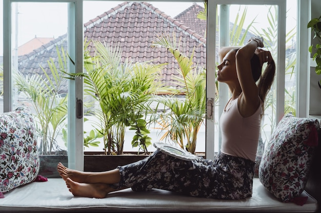 tropical interior design beautiful home interiors.htm beautiful brunette woman in loft home in tropical location photo  beautiful brunette woman in loft home