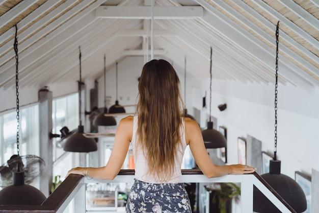 Beautiful brunette woman in loft home