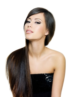 Beautiful brunette woman with long straight brown hair,  isolated on white background