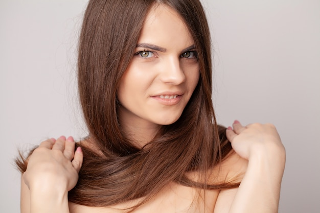 Beautiful brunette woman with long straight hair