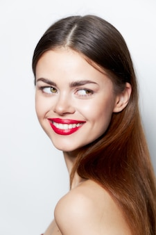 Beautiful brunette woman with red lips