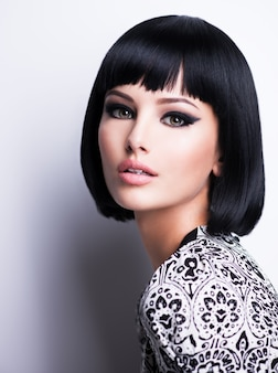 Beautiful brunette woman with short hairstyle