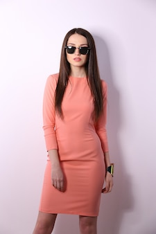 Beautiful brunette woman with sunglasses and long hair posing
