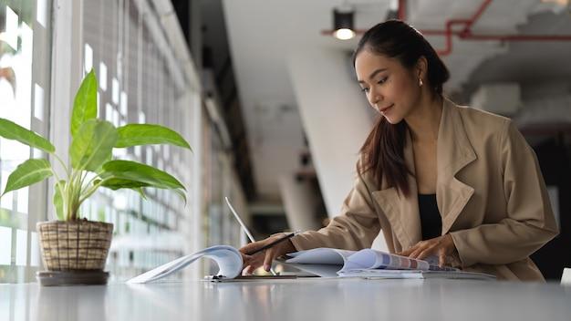 Beautiful brunette woman working in her office