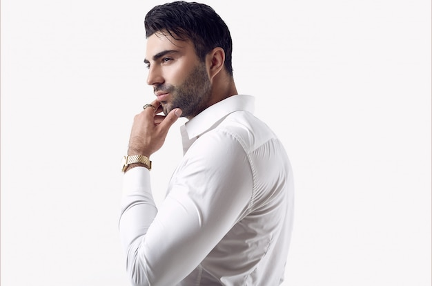 Beautiful brutal tanned businessman in a white shirt and sunglasses