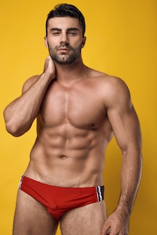 Beautiful brutal tanned muscular man wearing a red underwear