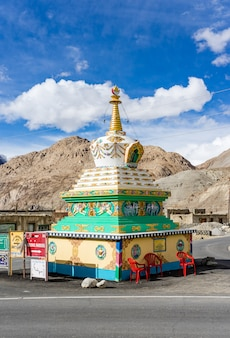 Beautiful buddhist stupa with blue sky cloudy near pangong lake in leh, ladakh,