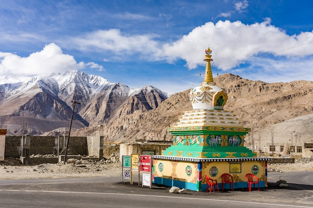 Beautiful buddhist stupa with blue sky cloudy near pangong lake in leh, ladakh