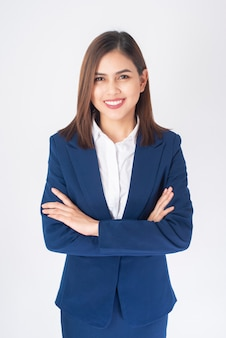 Beautiful business woman in blue suit is smiling on white  background