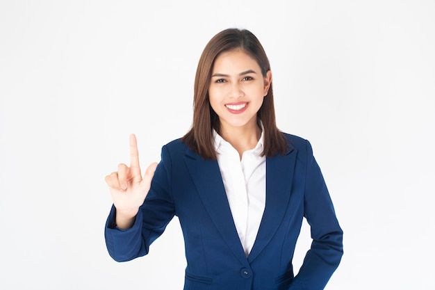 Beautiful business woman in blue suit is touching virtual screen on white background
