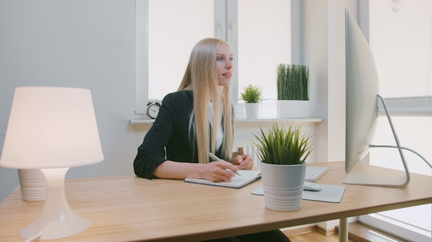 Beautiful business woman concentrating on work.