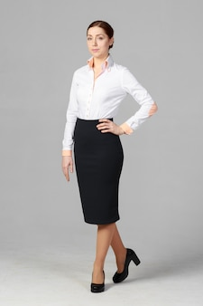 Beautiful business woman on grey