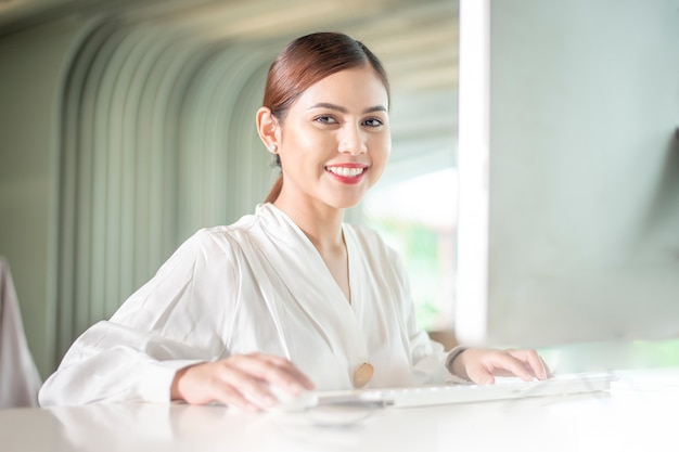 Beautiful business woman is working with her computer
