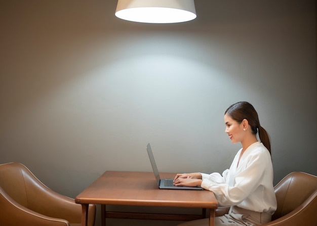 Beautiful business  woman is working with laptop in cafe