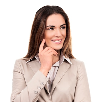 Beautiful business woman posing isolated over white