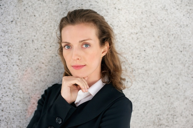 Beautiful business woman posing with hand on chin