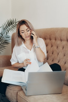 Beautiful business woman working at home.
