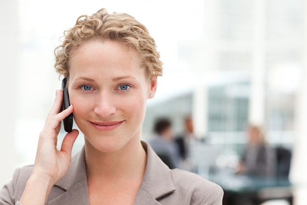 Beautiful businesswoman phoning in her office