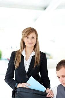 Beautiful businesswoman preparing her briefcase