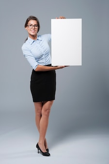 Beautiful businesswoman showing the whiteboard