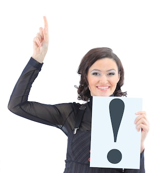 Beautiful businesswoman with a sign exclamation mark. isolated on a white wall.