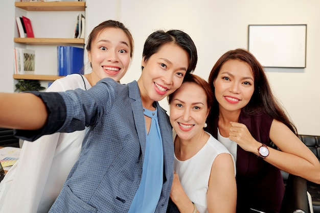 Beautiful businesswomen taking selfie