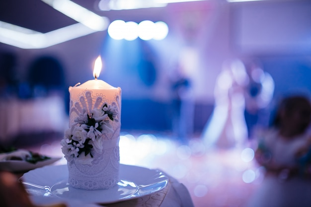 Beautiful candle at the wedding evening.