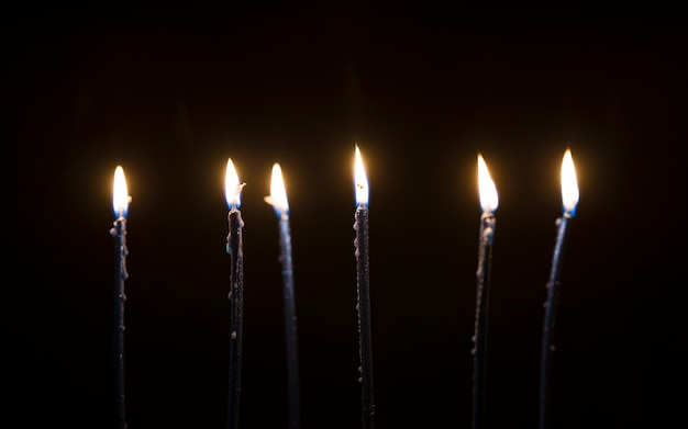 Beautiful candles burning in the dark