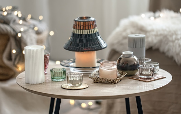 Beautiful candles in the scandinavian style on a blurred background with bokeh.