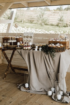 Beautiful candy bar decorated in beige and white colors