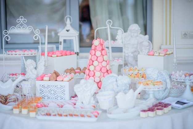 Beautiful candy bar of pink and white sweets decorated