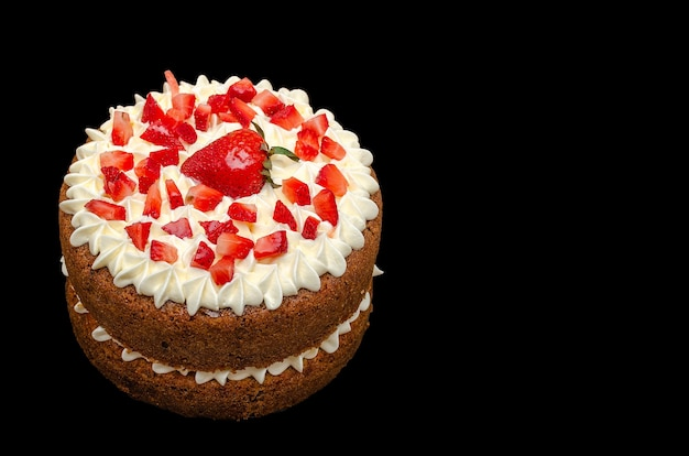 Beautiful carrot cake decorated with strawberries and cream cheese frosting