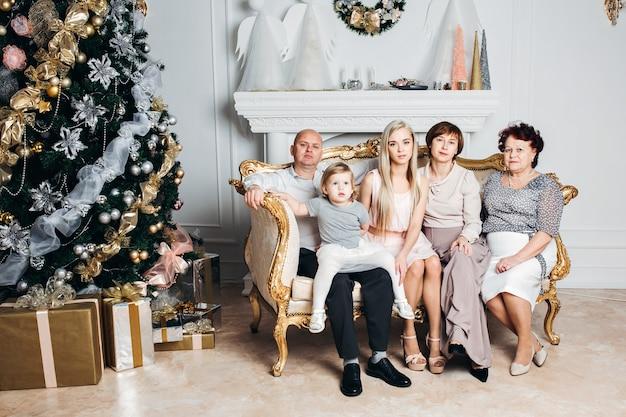 A beautiful caucasian family near the christmas tree