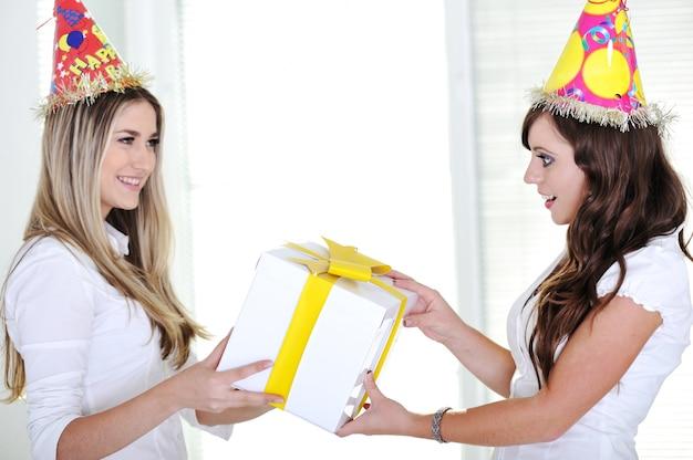 Beautiful caucasian girls wearing holiday hats
