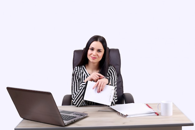 Beautiful caucasian woman dreams about something, sitting with a laptop net book isolated white wall charming young female freelancer thinking about new ideas while working on laptop