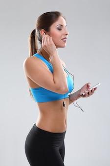 Beautiful caucasian woman in fitness wear