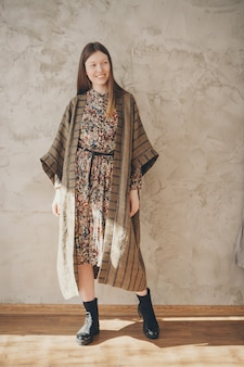 Beautiful caucasian woman in japanese kimono and black shoes.