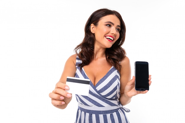Beautiful caucasian woman shows phone and card, picture isolated on white