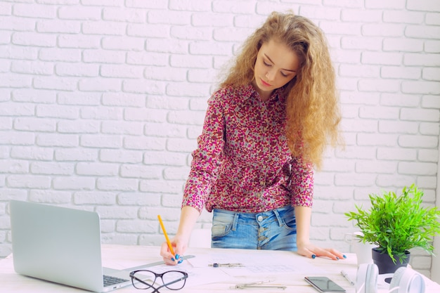 Beautiful caucasian woman sitting  and working on laptop