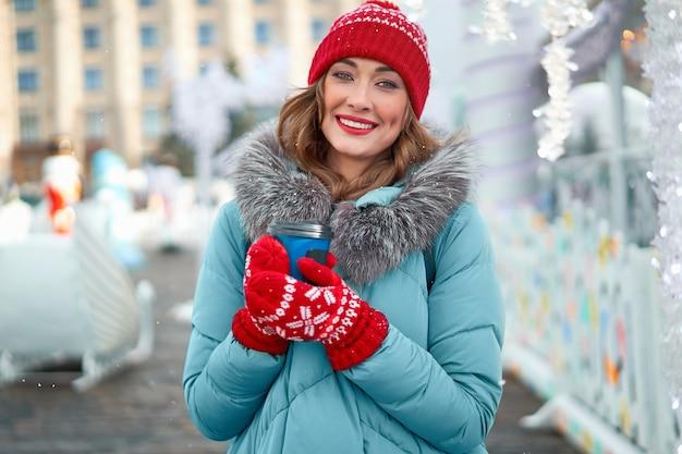 Beautiful caucasian woman standing christmas fair winter holiday
