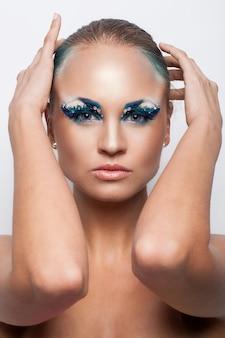 Beautiful caucasian woman with artistic makeup