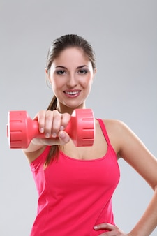 Beautiful caucasian woman with dumbbells