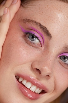 Beautiful caucasian woman with pink eyeliner
