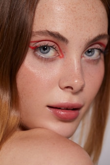 Beautiful caucasian woman with red eyeliner