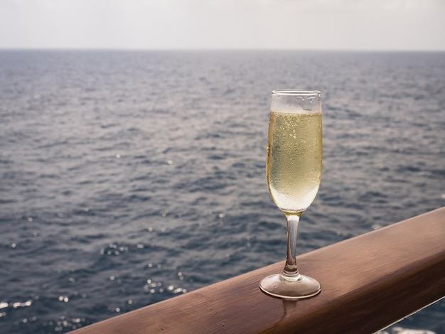 Beautiful champagne glass on the open deck