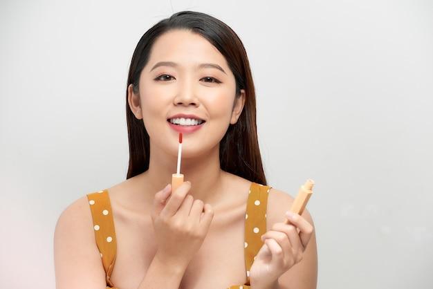 Beautiful cheerful girl apply stylish make up. female beauty model
