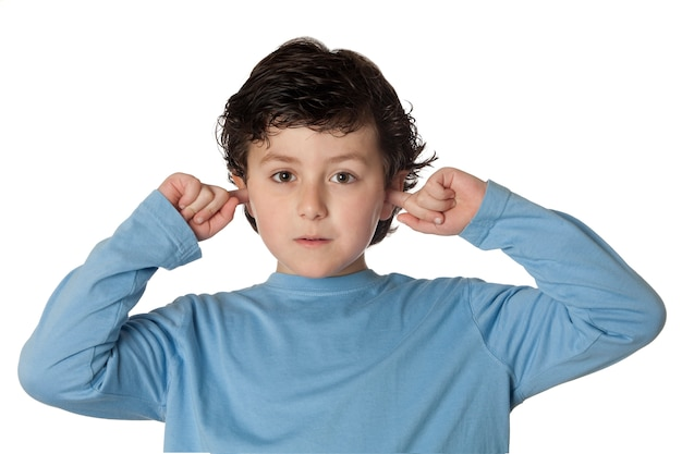 Beautiful chil covering the ears isolated on white background