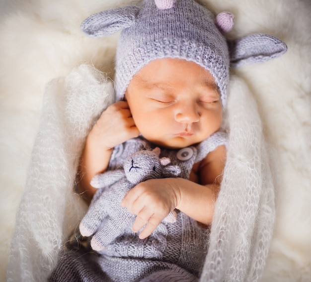 Beautiful child enveloped in knitted scarf